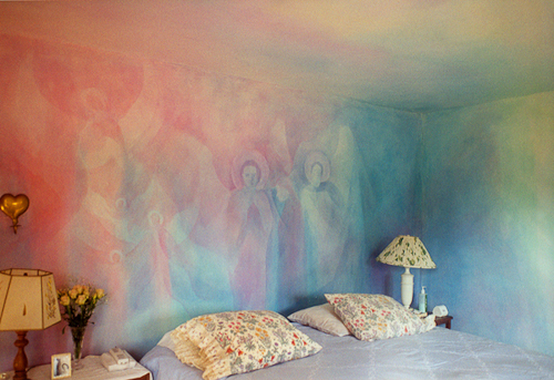 bedroom with pink and blue mural